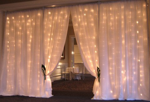 fairylit draped entrance way